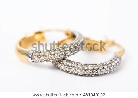 two golden earrings with diamonds stock photo © kirs-ua