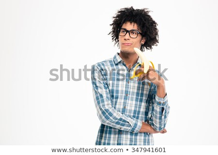Funny afro american man holding banana  Stock photo © deandrobot