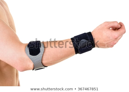Man Wearing Wrist and Elbow Braces in Studio Stock photo © belahoche
