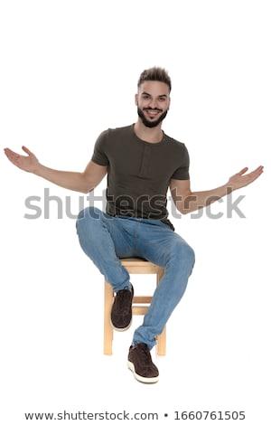 Sentado casual hombre abierto armas retrato Foto stock © feedough