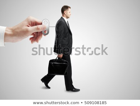 Businessman with key on back Stock photo © cherezoff