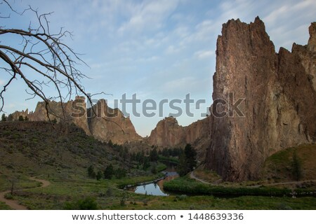 sun rises on smith rock oregon crooked river reflection stock photo © cboswell