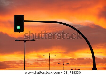 green traffic light in a dramatic sunset stock photo © capturelight