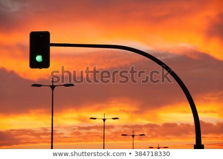 Stock fotó: Zöld · jelzőlámpa · drámai · naplemente · piros · égbolt