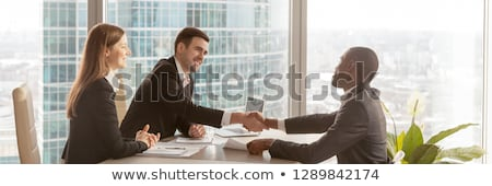 Empresario mujer de negocios apretón de manos oficina gente de la oficina saludo Foto stock © stevanovicigor