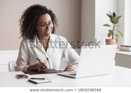 Stock photo: Student using laptop for education.