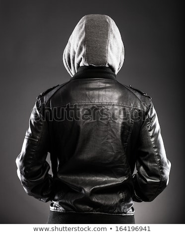 portrait of a serious man in leather jacket  stock photo © feedough