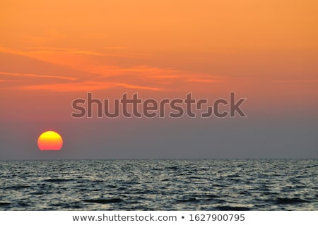 Sunset over sea with reflection in water as background Stock photo © smuki