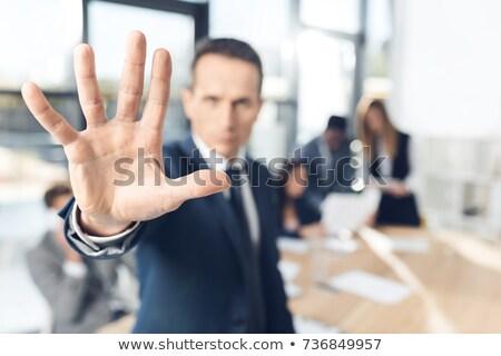 Сток-фото: мужчины · исполнительного · знак · остановки · белый · человека
