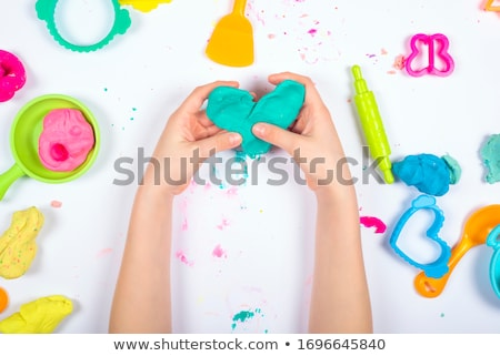 close up of girl molding a clay with hand tool stock photo © wavebreak_media
