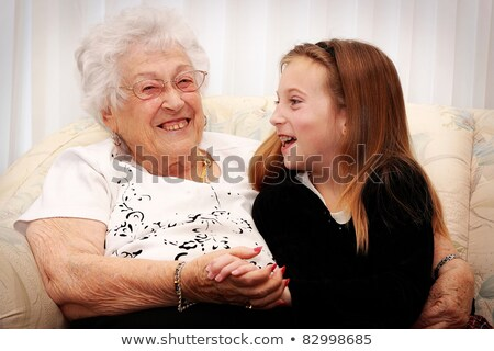 Grandmother and granddaughter splashing Stock photo © IS2