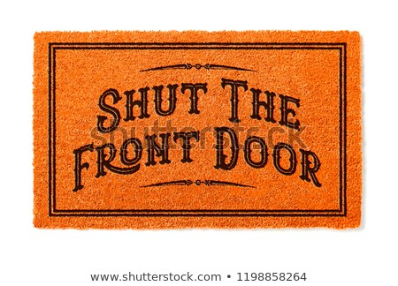Shut The Front Door Halloween Orange Welcome Mat Isolated on Whi Stock photo © feverpitch