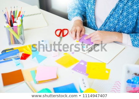 Woman's hand cut paper Making a scrap booking or other festive d Stock photo © snowing