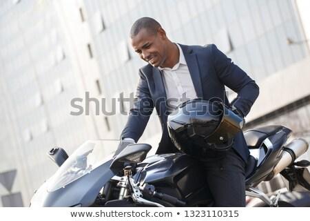 Opgewonden jonge zakenman paardrijden motor buitenshuis Stockfoto © deandrobot