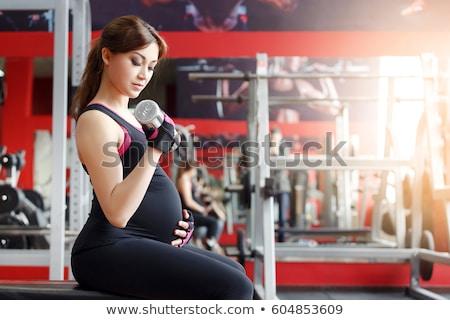 Ciąży kobiet sprzęt sportowy siłowni ciąży fitness Zdjęcia stock © dolgachov