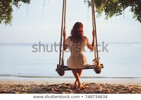 Tatil mutlu genç kadın oturma salıncak Stok fotoğraf © galitskaya