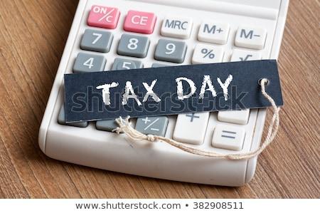 TAX DAY text Stock photo © Oakozhan