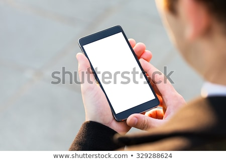 close up of businessman holding mobile phone stock photo © deandrobot