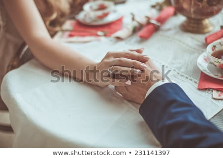 Esküvői csokor kéz a kézben pár lány fehér ruha fickó Stock fotó © Illia