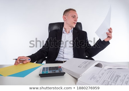 Businessperson Inspecting Financial Data Stock photo © AndreyPopov