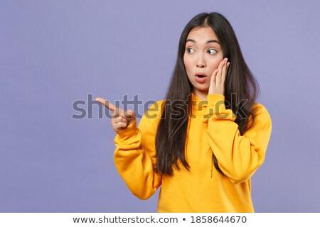 Imagen jóvenes morena Asia mujer senalando Foto stock © deandrobot