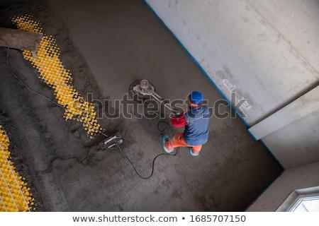Stock photo: Craftsman Leveling The Floor