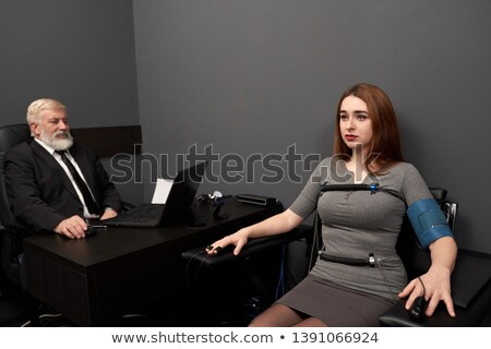 woman in a suit lying and looking serious Stock photo © photography33