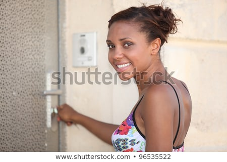young metis woman  opening a metallic door Stock photo © photography33