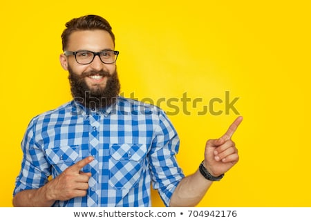 man pointing and looking to side stock photo © feedough