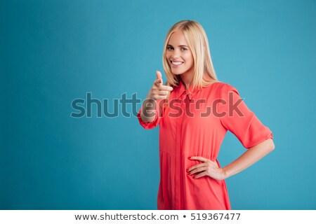 stijlvol · blond · tienermeisje · wijzend · uit · modieus - stockfoto © stockyimages