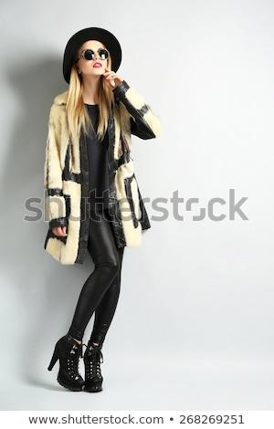 Woman posing in a hat Stock photo © wavebreak_media