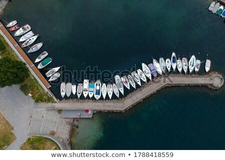 Kilátás móló kikötő férfi hal sport Stock fotó © aetb