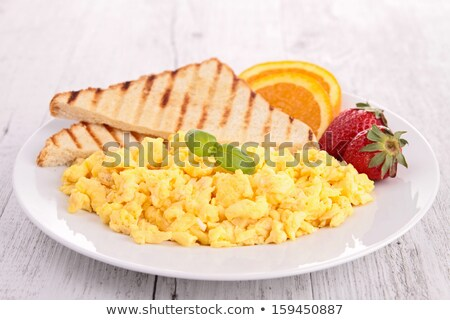scrambled egg with toast and strawberry Stock photo © M-studio