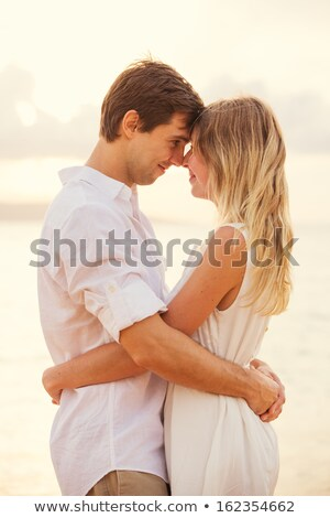 Young romantic couple embracing eachother Stock photo © get4net