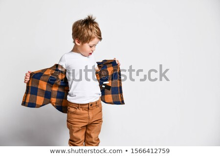 casual man unbuttoning his shirt stock photo © feedough