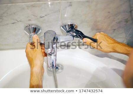 ключа · сантехники · водопроводчика · инструментом - Сток-фото © kurhan