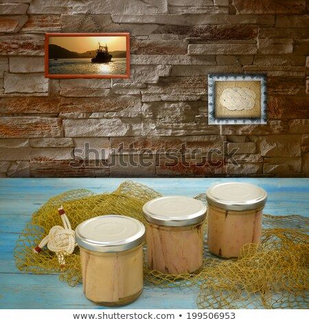 Stock photo: northern albacore in olive oi canned glass jar