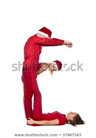 elfs forming the letter e stock photo © gemenacom