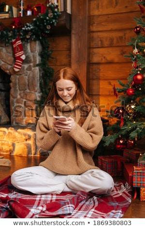 fiatal · nő · tart · ajándék · karácsonyfa · vonzó · nő - stock fotó © id7100
