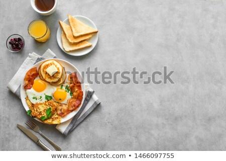áfonya · palacsinták · tányér · villa · fa · asztal · fa - stock fotó © klinker