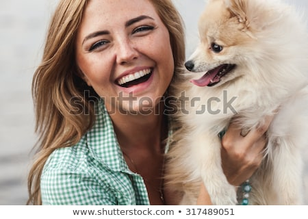 brunette hugging little dog stock photo © acidgrey