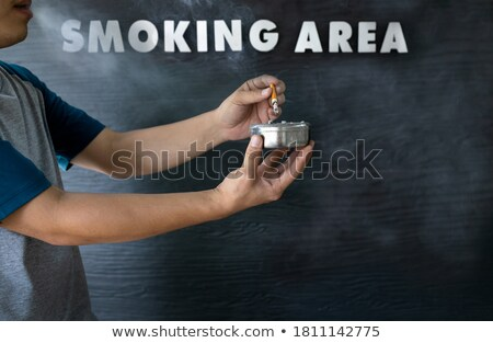 Hand extinguishes his cigarette. Stock photo © All32