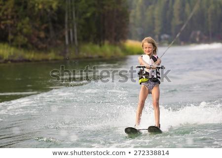 Beautiful waterskier girl on water ski Stock photo © Aleksangel