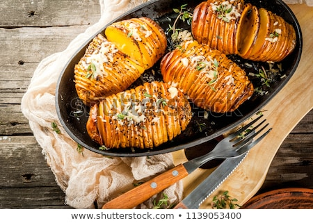 Swedish Potato Hasselback Stock photo © milsiart