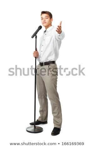 Atraente moço cantora microfone indicação Foto stock © deandrobot