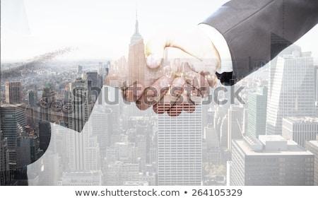 composite image of handshake between two women stock photo © wavebreak_media