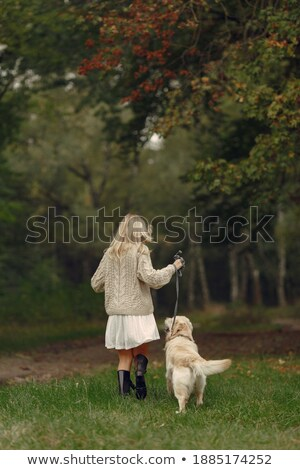 Mom and daughter in sweaters play with pet dog Stock photo © dash