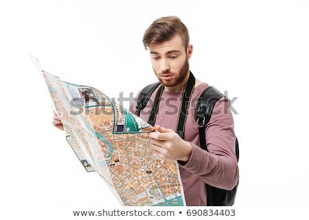 Szakállas férfi néz térkép kéz másfelé néz Stock fotó © tekso