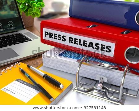 Citromsárga iroda mappa felirat üzlet hírek Stock fotó © tashatuvango