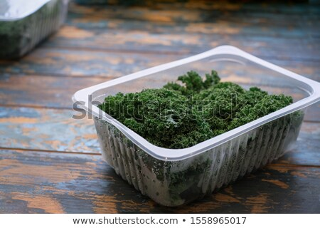 Fresh raw lettuce packed in plastic box ready to sell Stock photo © Virgin